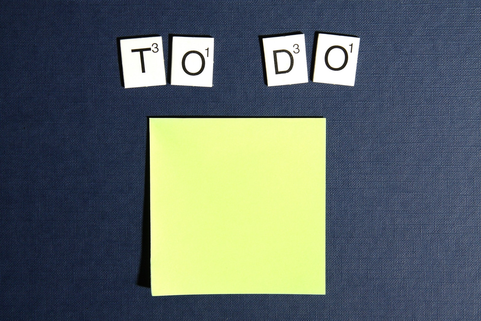 sticky notes that says to-do above it with Scrabble letters