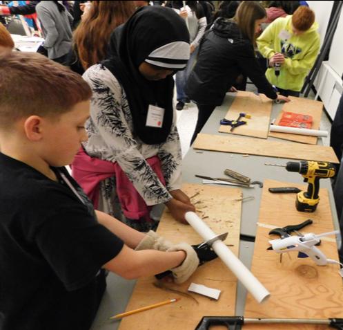 Students building a prosthetic leg