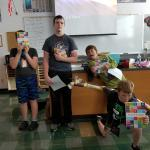 Students with their invention notebooks