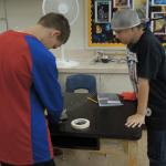 Students invent using everyday objects in Junkyard Wars.