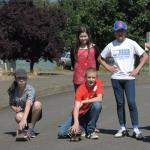 Students line up to race their solar-powered cars.