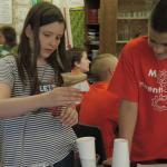 Students test water purification using their water filter design.