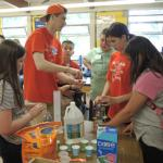 Students gather supplies to fuel chemical-powered cars.