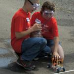 Students test a chemical-powered car.