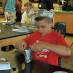 A student creates a duct tape invention for their client.