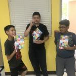 Three boys with invention notebooks